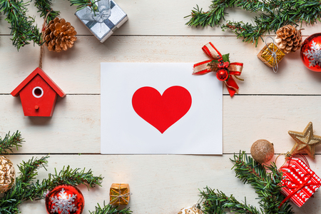 Christmas background with decorations with greeting cards on wooden background. Top view with copy space
