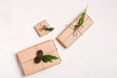 Christmas presents. Packages wrapped in kraft paper tied with jute