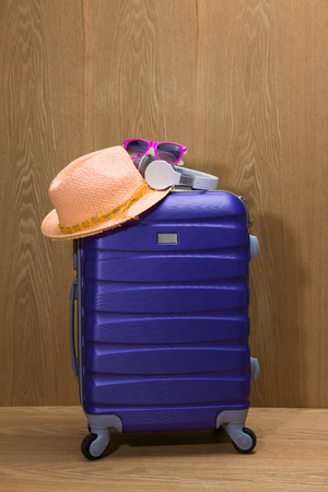 Its summer time. Travel bag and straw hat.