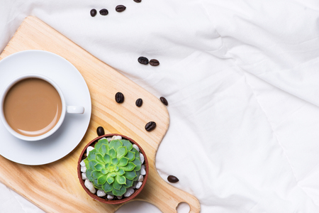 Morning coffee on bed top view, woman creative business concept