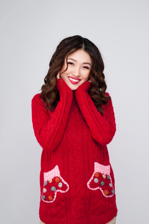 Portrait of beauty winter asian girl in red knitted woolen dress