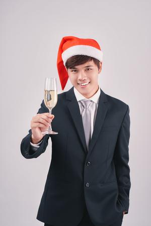 Asian businessman celebrating christmas isolated on white background
