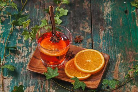 Christmas mulled wine on a rustic wooden table. Holidays concept.