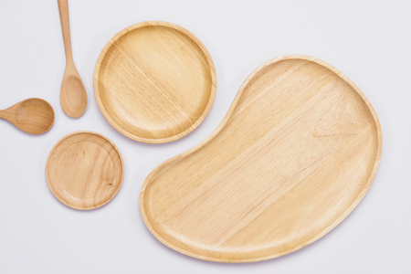 Set of wooden plates on the white background