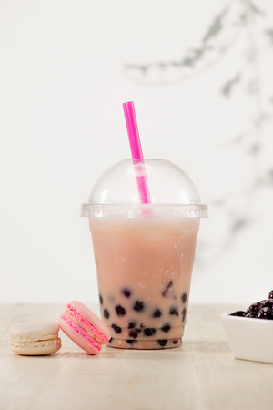 Strawberry Boba Bubble Tea with candy and ice.