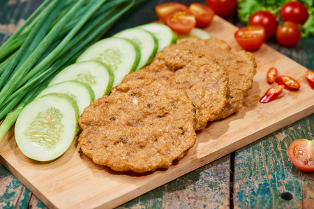 Vietnam fried fish patty with vegetable and sauce. Stock Photo