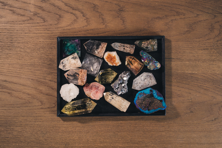 Many different natural stones on wooden background. Stock Photo
