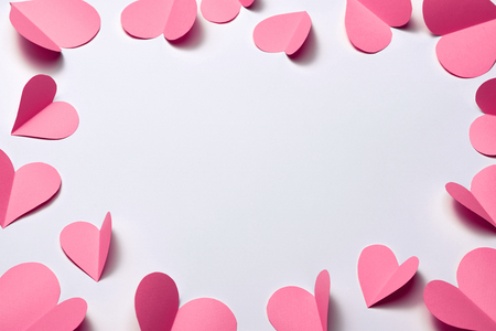 Beautiful pink paper hearts on white paper background Stockfoto