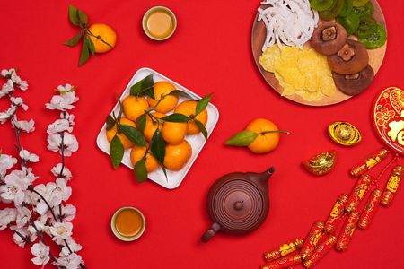 Flat lay Chinese new year new year table top shot. Toddler stealing food from table.