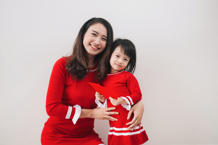Vietnamese mother and daughter celebrate new year at home. Tet Holiday.