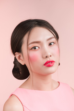 Close up fashion portrait woman against pink background.