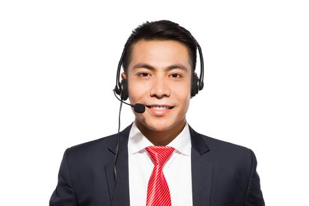 Young asian businessman wearing headset, studio shot. 版權商用圖片