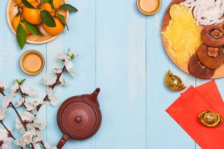 Conceptual flat lay Chinese New Year food and drink still life. Text appear in image: Prosperity, spring & good fortune.