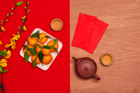 Overhead of top decorations Chinese New Year festive background concept.Mix variety essential accessory on modern grunge brown table house office desk.Other language mean rich or wealthy and happy.