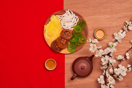Conceptual flat lay Chinese New Year food and drink still life. 免版税图像