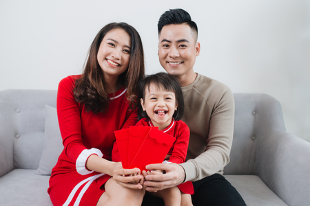 Happy Vietnamese family celebrate Lunar new year at home. Archivio Fotografico