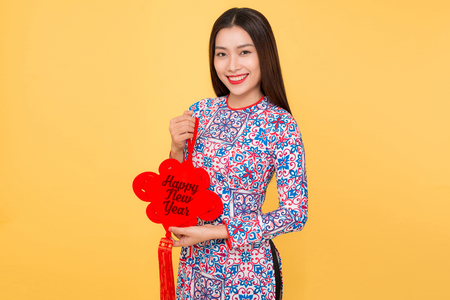 Vietnamese woman traditional festival costume Ao Dai holding attributes. Text mean Happiness. Banco de Imagens - 93002434