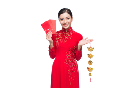 Full length of a beautiful Asian woman on traditional festival costume Ao Dai. Tet holiday. Lunar New Year.  Text mean Lucky and Happiness.