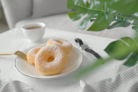 Classic donut breakfast on table in living room at home.