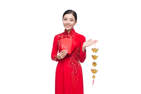 Full length of a beautiful Asian woman on traditional festival costume Ao Dai. Tet holiday. Lunar New Year. Text mean Happiness and Happy Banco de Imagens