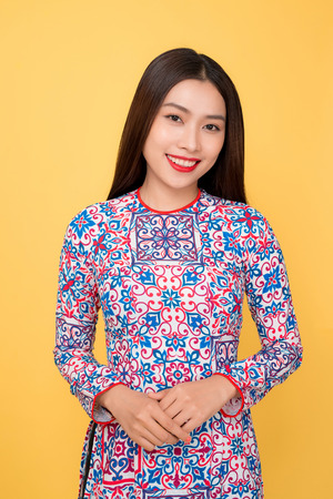 Vietnamese woman traditional festival costume Ao Dai. Tet holiday. Lunar New Year.