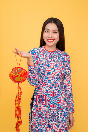 Vietnamese woman holding attributes. Tet holiday. Lunar New Year. Text mean Happiness