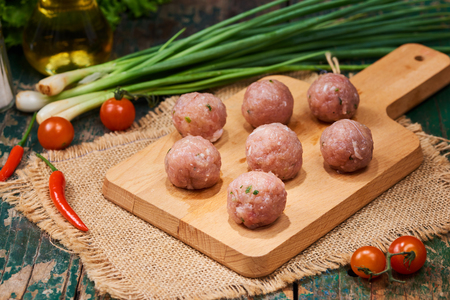 Homemade food. Raw fish ball in the kitchen with vegetables  Stock Photo