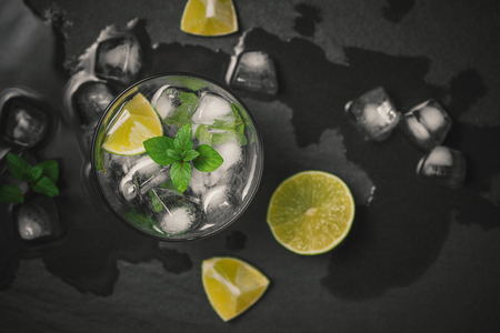 Mojito cocktail with lime and mint in glass on a grey stone background Stok Fotoğraf - 93130282