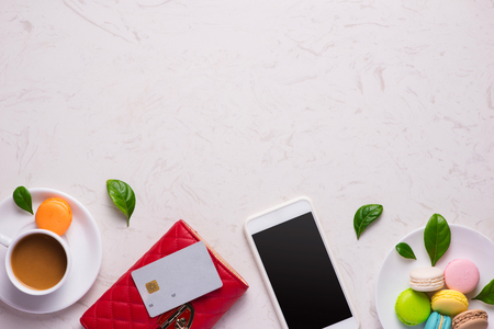 Workplace with stylish red leather wallet and smartphone Stock Photo