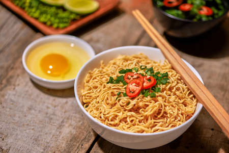 instant noodle in bowl cooked spicy taste topping with eggs