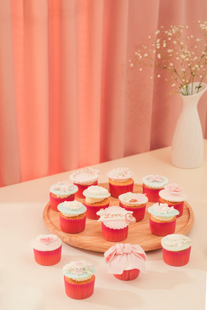 Valentine sweet love cupcakes on table on light background