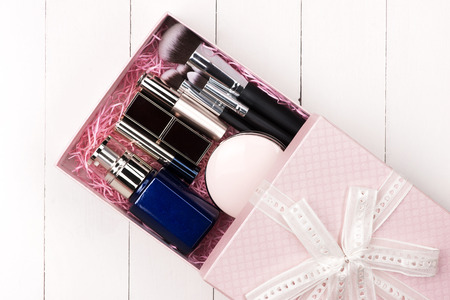 Cosmetics with a present box. Top view. Stock Photo