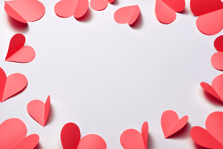 Beautiful pink paper hearts on white paper background 写真素材