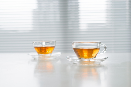 Cup of tea on the windowsill. Tea time.