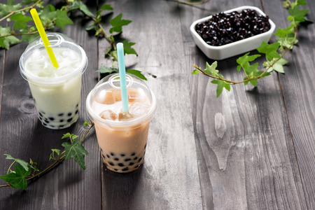 Milky bubble tea with tapioca pearls in plastic cup Stock Photo - 94114259