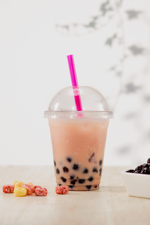 Strawberry Boba Bubble Tea with candy and crushed ice.