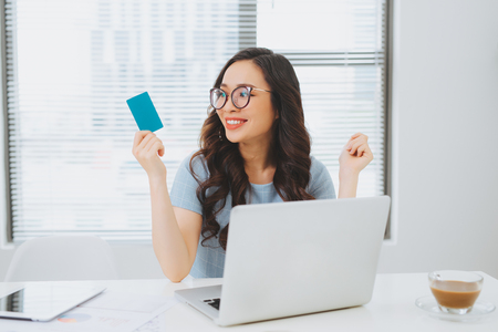 Young asian businesswoman using credit card for on-line payment Stock Photo