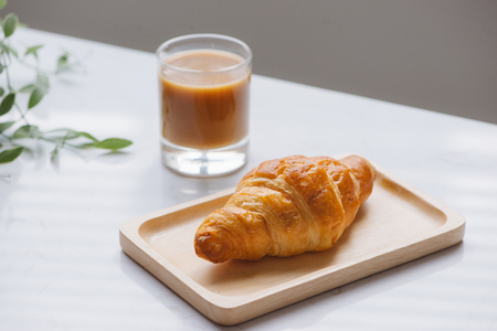 Morning breakfast with croissant and fruit juice 스톡 콘텐츠