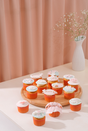 Yummy cupcakes. Valentine sweet love cupcake on table on light background