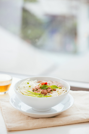 A bowl of traditional Vietnamese Pho noodle Stock Photo