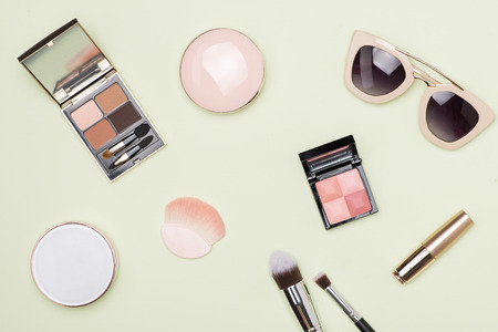 Set of decorative cosmetic products on color background