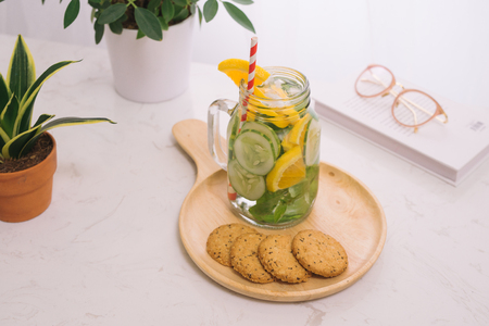 Detox water with vegetables and fruits. Diet healthy eating and weight loss. Stock Photo