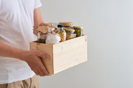 Volunteer with box of food for poor. Donation concept. Banque d'images