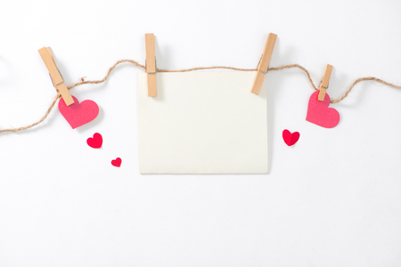 Love background. Greeting card with red paper hearts.