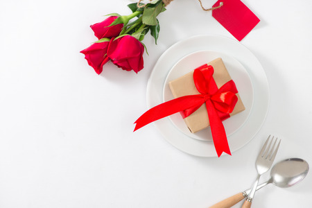 Festive table setting with cutlery, little rose and hearts on pink table