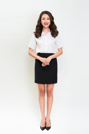 Full body portrait of happy smiling young beautiful business woman