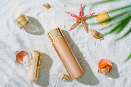 Summer beach vacation and accessories on sand background. Reklamní fotografie