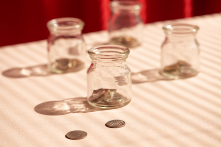 Coins in glass jar. Money savings concept