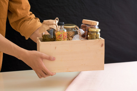 Volunteer with box of food for poor. Donation concept. Reklamní fotografie