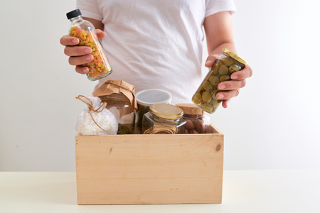 Volunteer with box of food for poor. Donation concept. Stock Photo